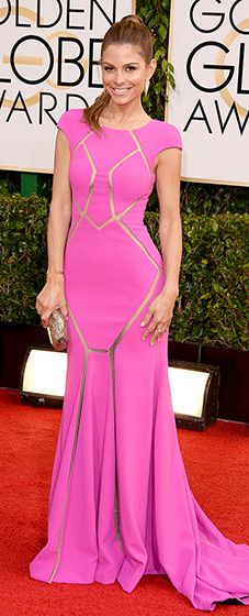 Maria Menounos : 2014 Golden Globes The TV personality looked perfect in a cap-sleeved, pink-lilac gown by Max Azria with sheer cutouts strategically placed in front to show some skin. She paired her sexy look with a clutch and high ponytail.