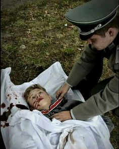 A sad site a hitlers youth dead reviving a iron cross