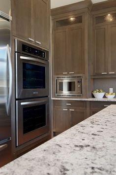 Veranda Interiors - kitchens - Bianco Argento, granite, countertops, double ovens, white granite countertops, white granite,  Amazing kitchen