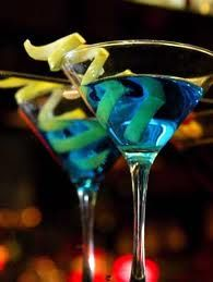 BLUE LEMON DROP MARTINI: 1 oz Vodka, 1 oz Blue Curacao, 4 oz lemonade, 1 lemon curl for garnish. DIRECTIONS: Pour liquids into a martini shaker filled with 1 cup ice and shake. Then strain into chilled martini glass and garnish with the lemon curl. Blue Martini Recipe, Lemon Martini, Martini Recipes, Cocktail Recipes, Drink Recipes, Lemon Drink, Pink Martini, Yummy Recipes, Recipies