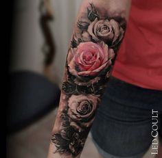 Beautiful rose tattoo on arm
