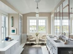 Check out this stunning bath with seating area under a window.   http://archdigest.com