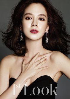 Song Ji Hyo | Denim black chiffon dress; Chaumet earrings | love the make up too! http://www.kworldstyle.com/2014/01/like-perfection-song-ji-hyo-for-1st-look.html