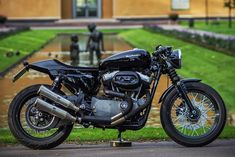 RocketGarage Cafe Racer: XL 1200 Rewheeled... Ditch the fork gaiters, otherwise I'm all good with this nice Sporty.