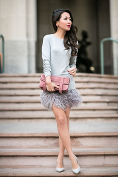 Tweet Happy Wednesday everyone! I'm such a huge fan of feather skirts and absolutely love the contrast of this particular dress. Feather skirts naturally have a glamorous aura, so the juxtaposition of the sweatshirt with the feather fringe is quite refreshing. It's the playful dance between simple casual items and intricate elegant pieces that I really . . .