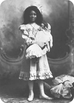 African American girl with Caucasian doll