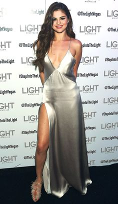 Selena Gomez in a plunging silver high-slit Galvan dress