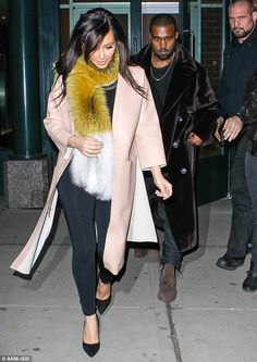 Kim Kardashian takes foxy lady look too far with bizarre furry scarf as she heads out on date with Kanye West  Photo: Wagner AZ