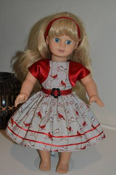 I dont know what it is, but I just LOVE this fabric!! It is a subtle gray background with the prettiest little red and white cardinal on branches. I have made a Christmas dress, headband, belt and bolero for your 18 inch doll such as American Girl, Madame Alexander, Journey Girls or any