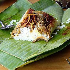 Known as Malaysia's national dish, Nasi Lemak — in its breakfast form — consists of coconut rice, cucumber, anchovies, roasted peanuts, hard-cooked egg, and sambal (spicy sauce) served in a banana leaf, newspaper, or brown paper. Want to try a dish cooked in banana leaves? Check out Spicy Whole Fish Grilled in Banana Leaves.