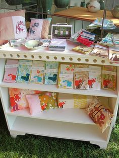 small bookcases painted bright colors.  On the floor or stacked on top of tables.