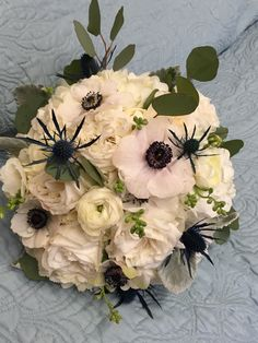 Bridal bouquet. Maid of honor. Bridesmaids. Flower girl. White. Blue. Anemone. Garden roses. Hydrangeas. Thistle. Eucalyptus. Spring. Summer. Fall. Winter. Wedding.