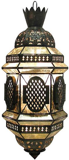 This hammered tin chandelier design was influenced by colonial style. Lamp is decorated with tin ornaments and hammered glass.