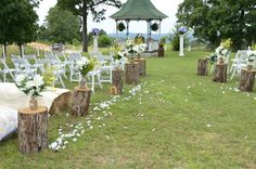 Hoping to do hay bail seating like this and the logs at the end of each aisle with bouquets is an awesome idea!