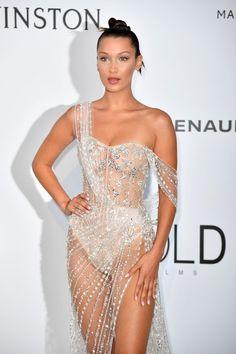 US model Bella Hadid poses as she arrives for amfAR's 24th Cinema Against AIDS Gala.