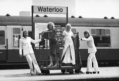 Swedish pop stars (from left), Benny Andersson, Anni-Frid Lyngstad, Agnetha Faltskog and Bjorn Ulvaeus of the Swedish pop group ABBA posing at Waterloo railway station, 10th April 1974. (Photo by John Downing/Express/Getty Images)