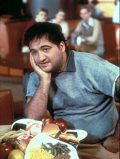 When wearing a collared shirt under a sweater: collar in or collar out?  In. Unless you're going for the whole John Belushi look.