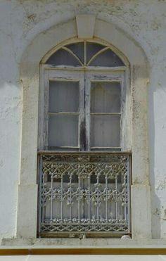 Old window with balcony. Old town Albufiera Algarve Portugal