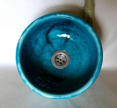 A very small sink in turquoise-green with moving form, hand worked and glazed. Brenntempertatur: 1100 ° C. No cracks in the glaze! Glazed outside. It can be used as a sit-on basin. The appropriate drain is included. Dimensions: Diameter 24 cm / height 11.5 cm. More on: