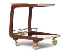 View this item and discover similar for sale at - A two-tiered cart in solid walnut with brass details and wheels. Design by Carl Aubock made by Aubock Atelier Round End Tables, Round Bar, Antique Tea Cart, Rolling Bar Cart, Coffee Carts, Serving Cart, Small Bars, Wet Bars, Table Furniture