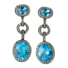 Have you seen our Black Gold Collection?  http://jewelrydistrict.net/collections/black-gold  Blue Topaz and Diamond Dangle Earrings 14k Black Gold