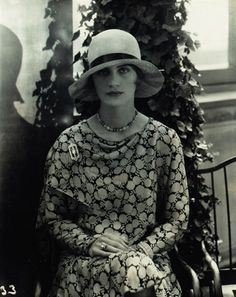 Edward Steichen. Lee Miller modeling Marie-Christiane hat and dress and jewelry