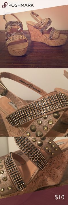 Not Rated bejeweled wedges Size 6.5 wedges with gold/ amber jewels and gold spikes. Good condition with minor flaws in jewels in a couple places (pictures attached). Not Rated Shoes Wedges