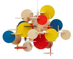 Slotted building disks in primary colors. Normann Copenhagen - Bau