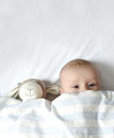 cute baby under blanket with teddy bear
