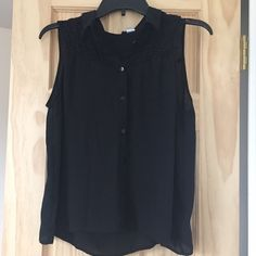 Black Button Down Top Sleeveless, black, button down. Has lace on upper part of the front of the shirt. NEVER worn. Fits as a Large. H&M Tops Button Down Shirts