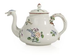 A DOCCIA PORCELAIN TEAPOT AND COVER CIRCA 1765-70 painted with scattered colorful flower sprays and sprigs, the spout modelled as a bird's head, the twig-form handle issuing leaves and buds. height 4 5/8 in.
