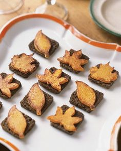 Delight one and all with this festive Thanksgiving finger food! Mini squares of toasted pumpernickel bread are topped with dollops of goat cheese and butternut squash cut into leaf shapes.