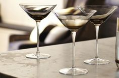 Beautiful, sparkling glassware adds the finishing touch to any table. Our stunning Capri glassware, feature elegant stems and a graduated smoked taupe tint for a stylish design and refined finish. Christmas Entertaining, Christmas Drinks, Kelly Hoppen, Unique Home Accessories, Bars And Clubs, Autumn Inspiration, Restaurant Bar, Martini, A Table