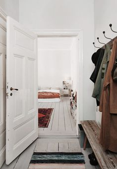entrance coat hanging rack and stool for bags and shoes.