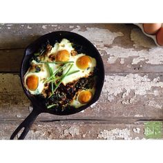 Baked Eggs with Garlic Kale and Sun-dried Tomatoes. by nutritionstripped #Eggs #Kale #Healthy
