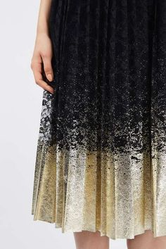 Turn heads in this eye-catching dress in navy blue with a contrast foil hem in pleat metallic. #Topshop