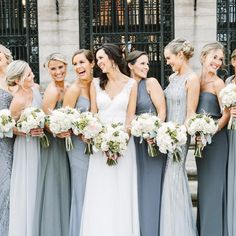 Pretty & happy bride and bridesmaids in shades of grey-blue