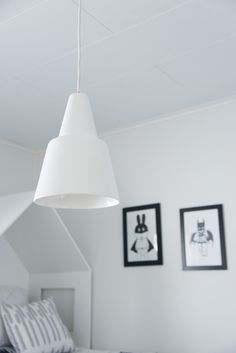 Simple White porcelain pendant lamp in a bedroom Vilho I Juho Pasila