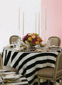You can never go wrong with something classic like this black and white striped tablecloth. It can be modern or class and is a bit graphic. It works with any color palette. The possibilities for flowers, stemware, dinnerware, etc. are endless against this ideal backdrop