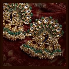 Indian peacock earrings from Sabyasachi Jewellery collection. #Frugal2Fab