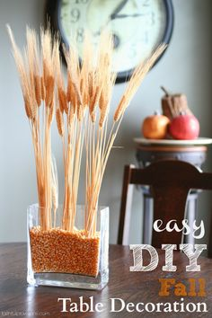 Easy DIY Fall Table Decoration - Design your table in 5 minutes, and it is perfect for any fall tablescape and costs less than $5. Perfect for a fall party!