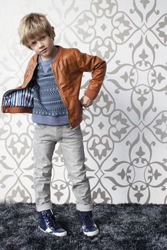 Little boy's outfit; leather jacket, sweater, grey jeans, & high tops