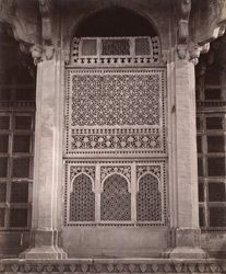 Photograph of the Tomb of Muhammad Ghaus at Gwalior in Madhya Pradesh, taken by Bourne and Shepherd around 1883, from the Archaeological Survey of India Collections. Muhammad Ghaus was a celebrated Muslim saint who died in 1563. His tomb dates from c.1565 and is a fine example of early Mughal architecture from the reign of Emperor Akbar (r.1556-1605). It is situated near the great hill fortress of Gwalior, held by the Mughals between the 16th and 18th centuries. The tomb is a square stone…