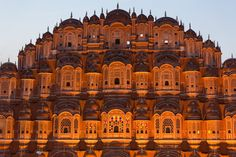 """#HawaMahal - The decorative #facade of this #""""Palace of Winds"""" may be a distinguished landmark in #Jaipur. Their five-storey structures of arenaceous rock plastered pink crustlike with fine trelliswork and elaborate balconies. The #palace has 953 niches and windows. in-built 1799 by Pratap Singh, the #Mahal was a royal grandstand for the palace ladies."""