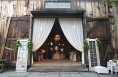 I like the dramatic swag of the draperies in the barn door. So gorgeous and picturesque!