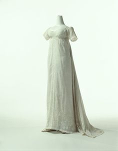 Chemise Dress, France c 1802, White cotton muslin dress with train; floral embroidery at front panel and hem; drawn work at center front, sleeves and neckline