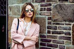 Beautiful fashion model woman on sunglasses standing near brick wall stock photo