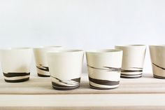 Artist-made, hand thrown ceramic mugs in hot chocolate brown and creamy white. Strata Cups, Set of Two by Julia Paul