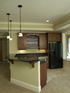 Could we knock that wall out and make it open like this? This layout is pretty for a small kitchen..