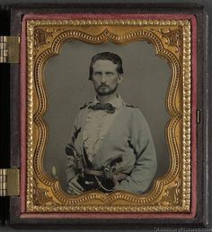 Unidentified soldier from Kentucky in Confederate uniform with two revolvers